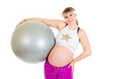Smiling pregnant woman holding fitness ball Stock Photography