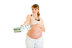 Smiling pregnant woman holding present for baby Stock Photo