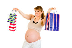 Smiling pregnant woman holding shopping bags Royalty Free Stock Photography