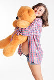 Smiling pregnant woman is holding teddy bear Royalty Free Stock Photo