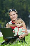 Smiling pregnant woman with laptop Royalty Free Stock Photo