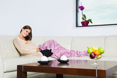 Smiling pregnant woman. Lying on sofa Royalty Free Stock Photos
