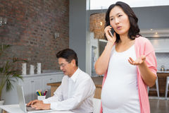 Smiling pregnant woman on a phone call Royalty Free Stock Images