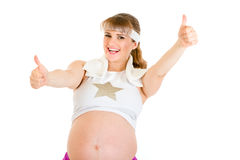 Smiling pregnant woman showing thumbs up gesture Royalty Free Stock Photo