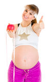 Smiling pregnant woman showing thumbs up gesture Stock Images