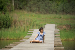 Lady on Wooden Bridge Royalty Free Stock Image