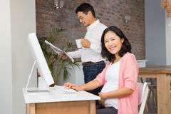 Smiling pregnant woman using laptop Stock Photography