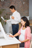 Smiling pregnant woman using laptop Royalty Free Stock Image
