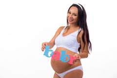 Smiling pregnant woman waiting for twins, girl and boy. Stock Photos