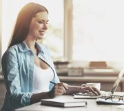 Smiling Pregnant Woman Working with Laptop at Home Royalty Free Stock Images