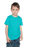 Smiling preschool boy in blue shirt Royalty Free Stock Photography