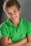 Smiling Preteen Boy. A portrait of a biracial tween in a green shirt Royalty Free Stock Images
