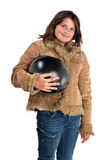 Smiling preteen girl holding bike helmet Stock Image