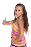 Smiling preteen girl holds her thumb up Stock Photos