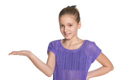 Smiling preteen girl makes a hand gesture Stock Images