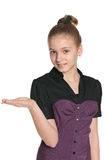 Smiling preteen girl makes hand gesture. A pretty preteen girl makes a hand gesture on the white background Royalty Free Stock Photo