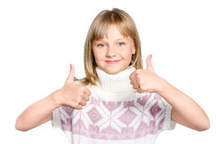 Smiling preteen girl makes thumb up sign isolated Royalty Free Stock Images