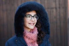 Smiling preteen girl wearing fur hood Stock Photos