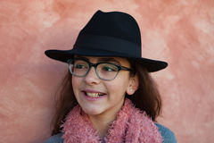 Smiling preteen girl wearing pink scarf Stock Image
