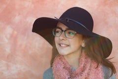 Smiling preteen girl wearing pink scarf Stock Photos