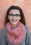 Smiling preteen girl wearing pink scarf Stock Photos