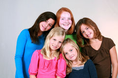 Smiling Preteens. Diverse group of pretty preteen girls smiling Stock Image