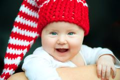 Baby in red hat Stock Photos
