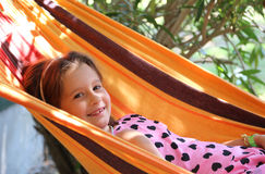 Smiling pretty baby rests in a hammock Stock Image