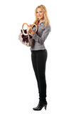 Smiling pretty blonde with a handbag. Isolated Royalty Free Stock Image