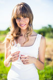 Smiling pretty blonde holding dandelion Royalty Free Stock Photography