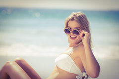 Smiling pretty blonde wearing sun glasses and looking at camera Stock Images