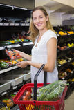 Smiling pretty blonde woman buying products Royalty Free Stock Images