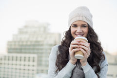 Smiling pretty brunette having coffee Stock Images