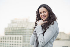 Smiling pretty brunette in winter clothes posing Stock Image