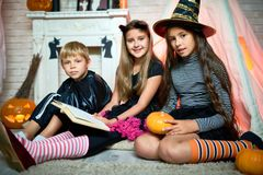 Positive kids in Halloween costumes royalty free stock image