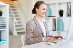 Smiling Pretty Entrepreneur at Work Royalty Free Stock Image