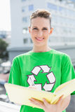 Smiling pretty environmental activist writing Royalty Free Stock Photo