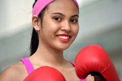 Smiling Pretty Female Boxer Wearing Boxing Gloves royalty free stock photography