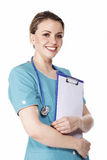 Smiling pretty female doctor holding a clipboard Royalty Free Stock Photography