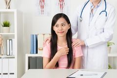 Smiling pretty female patient feeling warmth. When doctor concern her stock images