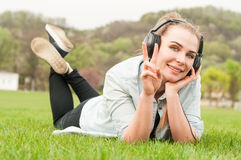 Smiling pretty female showing victory or peace sign Royalty Free Stock Photography