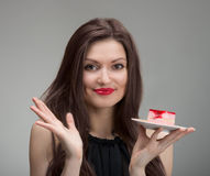 Smiling pretty girl with the cake Royalty Free Stock Photo