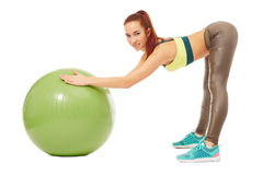 Smiling pretty girl engaged in aerobics Stock Image