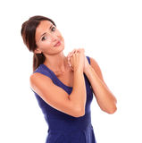 Smiling pretty girl gesturing praying sign Royalty Free Stock Image