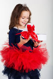 Smiling pretty girl is holding gift box with red Stock Images