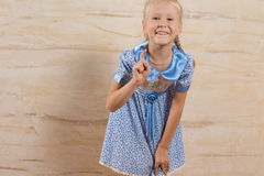 Smiling Pretty Girl Isolated on Wooden Wall Stock Image
