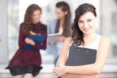 Smiling pretty girl looking at camera in college Royalty Free Stock Photo