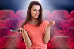 Smiling pretty girl looks at the camera at the cinema royalty free stock photography
