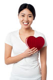 Smiling pretty girl with love heart Stock Images