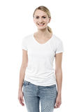 Smiling pretty girl posing to camera. Image of a young happy woman posing over white Royalty Free Stock Images
